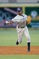 Shortstop Tim Beckham #22 of the Charlotte Stone Crabs makes a throw to first base against the Jupiter Hammerheads at Roger Dean Stadium June 16, 2010, in Jupiter, Florida.  Photo by Brian Westerholt /  Seam Images