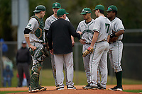 Dartmouth Big Green head coach Bob Whalen mound meeting with catcher Ben Rice (9), pitcher Jack Metzger (29), shortstop Bryce Daniel (4), second baseman Blake Crossing (13), and first baseman Oliver Campbell (27) during a game against the Indiana State Sycamores on February 21, 2020 at North Charlotte Regional Park in Port Charlotte, Florida.  Indiana State defeated Dartmouth 1-0.  (Mike Janes/Four Seam Images)