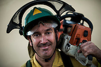 Carlos Pino diaz. Chainsaw. The firefighter from the BRICA Málaga 703, the Andalusian Service firefighting (INFOCA),  posses after a wildfire in Los Barrios near Cadiz on July 25, 2015. © Pedro ARMESTRE