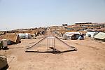 DOMIZ, IRAQ: A playground slide in the Domiz refugee camp...Over 7,000 Syrian Kurds have fled the violence in Syria and are living in the Domiz refugee camp in the semi-autonomous region of Iraqi Kurdistan...Photo by Ari Jalal/Metrography