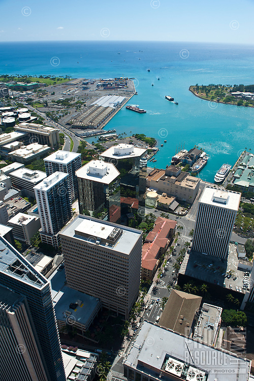 Aerial of downtown Honolulu and harbor looking down Bishop St