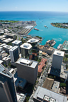 Aerial of downtown Honolulu and harbor looking down Bishop St