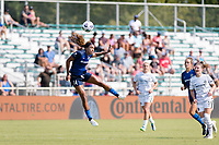 CARY, NC - SEPTEMBER 12: Jessica McDonald #14 of the NC Courage heads the ball during a game between Portland Thorns FC and North Carolina Courage at WakeMed Soccer Park on September 12, 2021 in Cary, North Carolina.