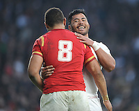 Manu Tuilagi of England shares a joke with Taulupe Faletau of Wales after the RBS 6 Nations match between England and Wales at Twickenham Stadium on Saturday 12th March 2016 (Photo: Rob Munro/Stewart Communications)