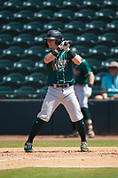 Patrick Dorrian (15) of the Greensboro Grasshoppers at bat against the Hickory Crawdads at L.P. Frans Stadium on May 26, 2019 in Hickory, North Carolina. The Crawdads defeated the Grasshoppers 10-8. (Brian Westerholt/Four Seam Images)