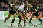 Berlin, Germany, February 01: Katharina Windfeder #8 of HTC Uhlenhorst Muehlheim vies for the ball with Elisa Graeve #26 of Duesseldorfer HC during the 1. Bundesliga Damen Hallensaison 2014/15 final hockey match between Duesseldorfer HC (white) and HTC Uhlenhorst Muehlheim (green) on February 1, 2015 at the Final Four tournament at Max-Schmeling-Halle in Berlin, Germany. Final score 4-1 (1-0). (Photo by Dirk Markgraf / www.265-images.com) *** Local caption ***