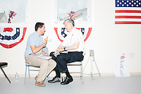 Campaign volunteer Christian Andzel (left) recruits Joe McCormack of Belmont, New Hampshire, for phone bank work for the Cruz campaign at the New Hampshire campaign headquarters of Texas senator and Republican presidential candidate Ted Cruz in Manchester, New Hampshire.
