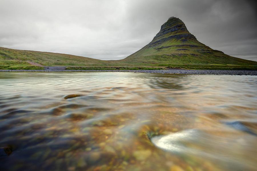 The Kirkjufellsa River flows below Kirkjufell (Church Mountain), Grundarfjordur, Snaefellsnes peninsula, West Iceland, Iceland
