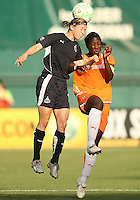 Rebecca Moros #19 of Washington Freedom heads the ball away from Anita Asante #5 of Sky Blue FC during a WPS match at RFK Stadium on May 23, 2009 in Washington D.C. Freedom won the match 2-1