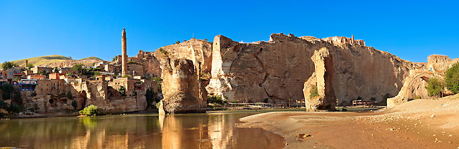 Remains of medieval Artukid Old Tigris Bridge – Built in 1116 by Artukid Fahrettin Karaaslan, the biggest in Anatolia at the time, with the old town Hasankeyf and its ruins on the cliffs abover the river Tigris. The minaret is of the El Rizk Mosque built 1409.  Turkey. 5