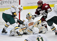 22 November 2011: University of Vermont Catamount goaltender Rob Madore, a Senior from Pittsburgh, PA, makes a third period save against the University of Massachusetts Minutemen at Gutterson Fieldhouse in Burlington, Vermont. The Catamounts defeated the Minutemen 2-1 in their annual pre-Thanksgiving meeting in the Hockey East season. Mandatory Credit: Ed Wolfstein Photo