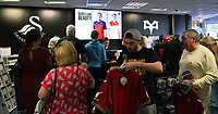 Pictured: Shoppers queue for the tills inside the store. Saturday 01 July 2017<br /> Re: The new 2017-2018 season, Swansea City FC kit has officially gone on sale at the club's Liberty Stadium shop, Wales, UK