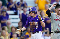 LSU Tigers outfielder Sean McMullen #7 celebrates after hitting a lead-off triple during the Southeastern Conference baseball game against the Georgia Bulldogs on March 22, 2014 at Alex Box Stadium in Baton Rouge, La. The Tigers defeated the Bulldogs 2-1. (Andrew Woolley/Four Seam Images)