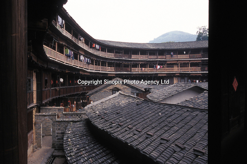 Interior of traditional Hakka Roundhouse, fort-like home to dozens of families, often several hundreds of years old in Fujian, China..