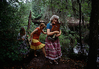 Musicians at the Florida Folklife Festival strum a dulcimer and stroll along the banks of the Suwannee River. <br /> Since 1953, the festival is held at the Stephen Foster Memorial hightlighting music, food and traditional arts of Florida's Southern Culture.