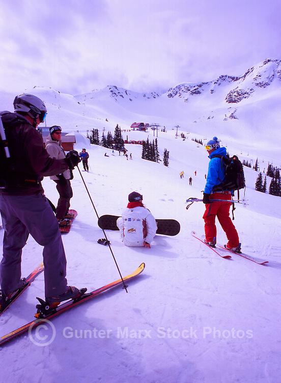 Whistler Ski Resort, BC, British Columbia, Canada - Friends downhill skiing and snowboarding on Whistler Mountain, Coast Mountains