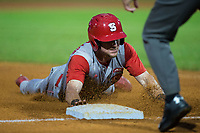 Brock Deatherage (13) of the North Carolina State Wolfpack slides head first into third base during the game against the North Carolina Tar Heels in Game Twelve of the 2017 ACC Baseball Championship at Louisville Slugger Field on May 26, 2017 in Louisville, Kentucky.  The Tar Heels defeated the Wolfpack 12-4 to advance to the semi-finals.  (Brian Westerholt/Four Seam Images)