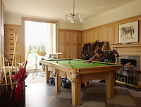 Charles plays billiards in the contemporary billiard room