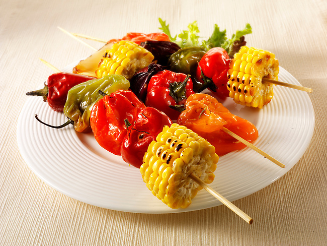 BBQ vegetarian kebabs of sweet corn, peppers & red onions. Funky Stock Photos images.
