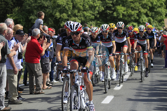 The peloton led by Yaroslav Popovytch (UKR), Jens Voigt (GER) and the rest of the Radioshack-Nissan team climbs the Cote De Barvaux during Stage 1 of the 99th edition of the Tour de France, running 198km from Liege to Seraing, Belgium. 1st July 2012.<br /> (Photo by Eoin Clarke/NEWSFILE)