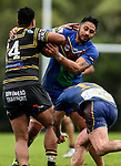 Andy Matano-Mauigoa of Howick tackles.  Fox Memorial Rugby League, Northcote Tigers v Howick Hornets, Birkenhead War Memorial Park Auckland, Saturday 22nd July 2017. Photo: Simon Watts / www.bwmedia.co.nz