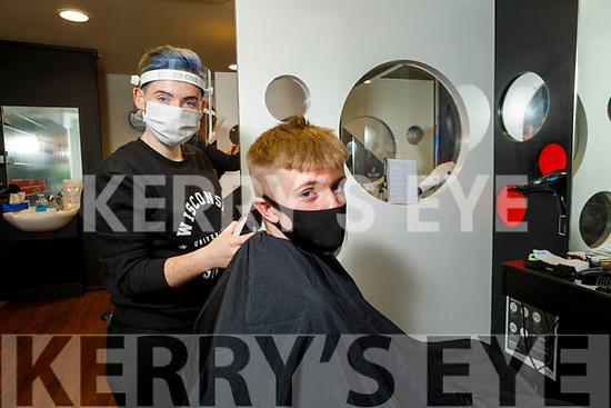 Conor O'Brien from Tralee getting his hair cut by Laura Horgan in Joe O'Brien Barbers, Ashe Street on Monday as he re opens his shop.