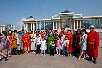 Mongolia, Ulaanbaatar. Family wedding party in Sukhbaatar Square