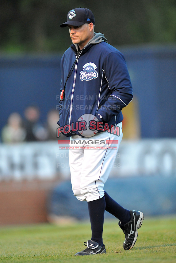 Asheville Tourists pitching coach Joey Eischen #38 leaves the mound during a game between the West Virginia Power and the Asheville Tourists at McCormick Field, Asheville, North Carolina April 10, 2012. The Tourists won 6-5  (Tony Farlow/Four Seam Images)..