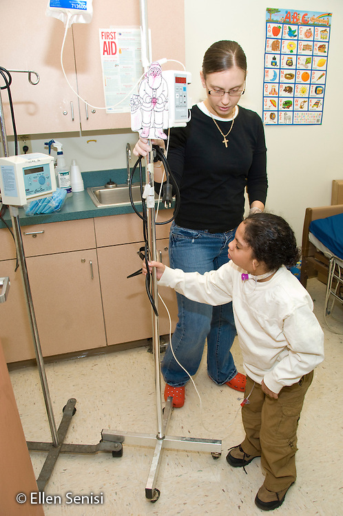 MR / Albany, NY.Langan School at Center for Disability Services .Ungraded private school which serves individuals with multiple disabilities.School nurse hooks student up to gastric tube feeding. Boy: 7, African-American, Pierre Robin syndrome, limited verbal output with expressive and receptive language delays.MR: Lif1, Smi24.© Ellen B. Senisi