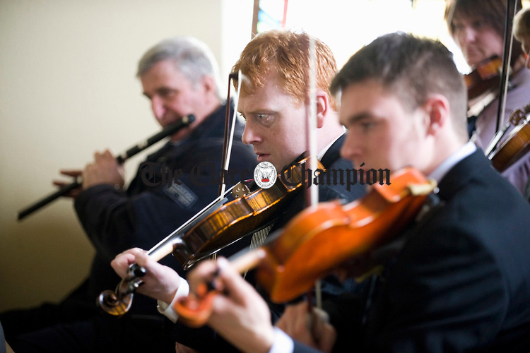 Johnny Kelly, centre, playing at the funeral of Joe Ryan in Inagh.