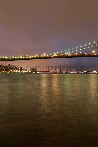AVAILABLE FROM JEFF AS A FINE ART PRINT.<br /> <br /> AVAILABLE FROM JEFF FOR LICENSING.<br /> <br /> The Brooklyn Bridge and the East River Illuminated at Night, Viewed from Lower Manhattan, New York City, New York State, USA