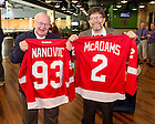 """Dec. 11, 2015; Bob Nanovic, left, and Jim McAdams hold personalized Detroit Red Wings jerseys presented to them after the NHL Alumni game at the Compton Family Ice Arena. The game was part of the Nanovic Institute for European Studies event """"Elite Athletes and the Cold War."""" (Photo by Matt Cashore/University of Notre Dame)"""