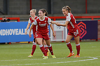 Lotte Wubben-Moy (centre) of Arsenal scores goal number 4 for her team and celebrates with Beth Mead of Arsenal (left) and Malin Gut of Arsenal (right) during Brighton & Hove Albion Women vs Arsenal Women, Barclays FA Women's Super League Football at Broadfield Stadium on 11th October 2020