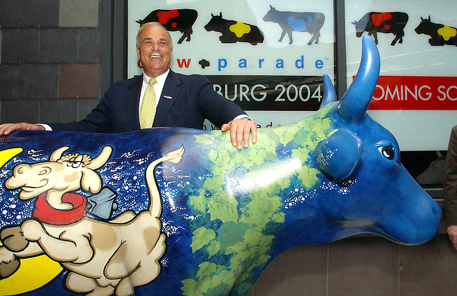 """Pennsylvania Gov. Ed Rendell holds a news conference  to announce the """"Cows Parade Harrisburg 2004"""" Tuesday July, 8, 2003 in Harrisburg. Gov. Rendell was supporting the Whitaker Center for Science and the Arts of Harrisburg in having fiberglass cow sculpters painted as artwork. Gov. Rendell wears the """"Got Milk"""" mustache for the event. (AP Photo/Brad C Bower)"""