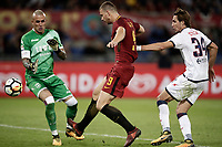 Calcio, Serie A: Roma, stadio Olimpico, 25 ottobre 2017.<br /> Roma's Edin Dzeko (c) in action with Crotone's Stefan Simic (r) and goalkeeper Alex Cordaz (l) during the Italian Serie A football match between AS Roma and Crotone at Rome's Olympic stadium, October 25, 2017.<br /> UPDATE IMAGES PRESS/Isabella Bonotto