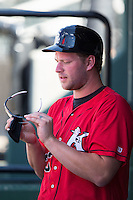 Kannapolis Intimidators manager Cole Armstrong (33) cleans his glasses during the game against the Greenville Drive at Intimidators Stadium on June 7, 2016 in Kannapolis, North Carolina.  The Drive defeated the Intimidators 4-1 in game one of a double header.  (Brian Westerholt/Four Seam Images)