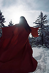Artistic dynamic photo of a beautiful asian woman in red undone kimono running on the snow through a winter forest into the sunlight Image © MaximImages, License at https://www.maximimages.com