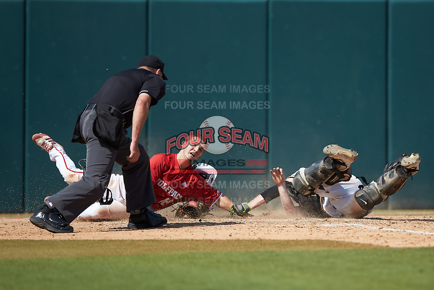 J.T. Jarrett (42) of the North Carolina State Wolfpack slides across home plate as Army Black Knights catcher Jon Rosoff (7) loses his glove while attempting to make the tag as home plate umpire Mike Jarboe looks on at Doak Field at Dail Park on June 3, 2018 in Raleigh, North Carolina. The Wolfpack defeated the Black Knights 11-1. (Brian Westerholt/Four Seam Images)
