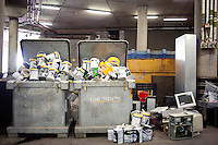 Empty paint cans that had contained the 'Wimbledon Green' colour  and discarded computer equipment disposed in refuse bins beneath No1 court at Wimbledon, The All England Lawn Tennis Club (AELTC), London....