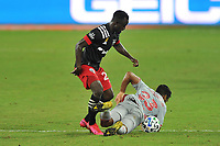 WASHINGTON, DC - SEPTEMBER 12: Cristian Casseres Jr. #23 of New York Red Bulls battles for the ball with Mohammed Abu #25 of D.C. United during a game between New York Red Bulls and D.C. United at Audi Field on September 12, 2020 in Washington, DC.