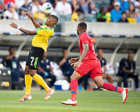 PHILADELPHIA, PA - JUNE 30: Leon Bailey #7 heads the ball as he is pursued by Eric Davis #15 during a game between Panama and Jamaica at Lincoln Financial FIeld on June 30, 2019 in Philadelphia, Pennsylvania.