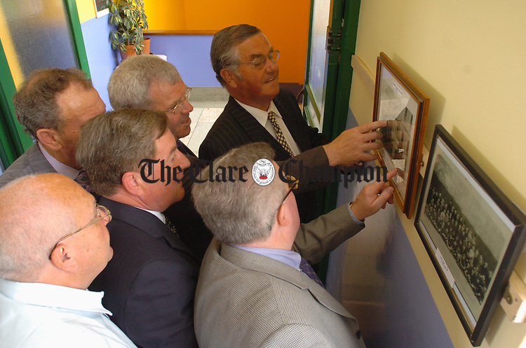 The lads gather round the old school photos at  the CBS 1954 sixth class reunion in Ennis. Photograph by John Kelly.