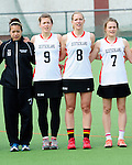 FRANKFURT AM MAIN, GERMANY - April 14: Nora Schroeder #10 of Germany, Kristina Schaefer #9 of Germany, Inga Hupka #8 of Germany and Pia Balz #7 of Germany during the national anthem before the Deutschland Lacrosse International Tournament match between Germany vs Great Britain during the on April 14, 2013 in Frankfurt am Main, Germany. Great Britain won, 10-9. (Photo by Dirk Markgraf)