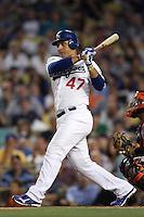Luis Cruz #47 of the Los Angeles Dodgers bats against the San Francisco Giants at Dodger Stadium on August 21, 2012 in Los Angeles, California. San Francisco defeated Los Angeles 4-1. (Larry Goren/Four Seam Images)