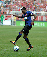 Manchester United defender Patrice Evra (3) plays the ball.  Manchester United defeated the Chicago Fire 3-1 at Soldier Field in Chicago, IL on July 23, 2011.