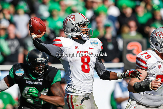 UNLV Rebels quarterback Caleb Herring (8) in action during the Heart of Dallas Bowl game between the North Texas Mean Green and the UNLV Rebels at the Cotton Bowl Stadium in Dallas, Texas. UNT defeats UNLV 36 to 14.