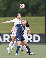 Harvard University midfielder Aisha Price (5) and Yale University forward Anne Song (6) battle for head ball. In overtime, Harvard University defeated Yale University,1-0, at Soldiers Field Soccer Stadium, on September 29, 2012.