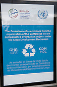 A notice explaining the Rio+20 conference's Greenhouse Gas offset under the UN Clean Development Mechanism at the Rio Centre. United Nations Conference on Sustainable Development (Rio+20), Rio de Janeiro, Brazil. Photo © Sue Cunningham.