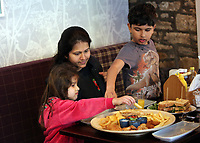 A young family enjoy a meal in the restaurant