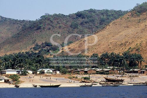 Tanzania. Village on the shore of Lake Tanganyika with dagar fish drying in the sun and fishing boats on the beach.